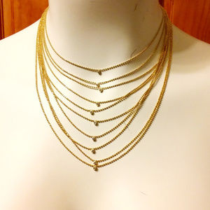 Women layered necklace gold tone finish